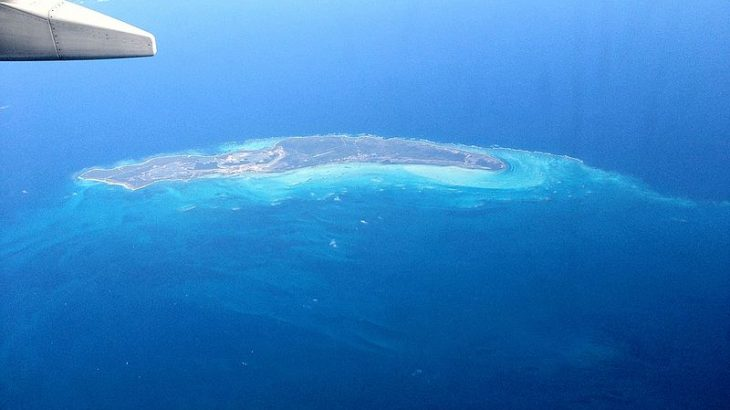 aerial-view-small-island-blue-ocean