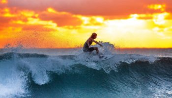 surfer-blue-wave-sunset