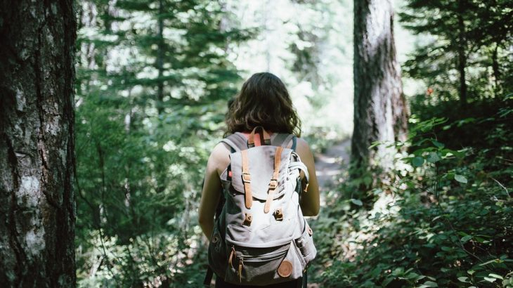 girl-backpack-hiking-forest