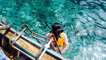 person-snorkeling-turquoise-water
