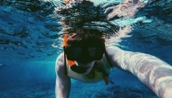 boy-snorkeling-blue-water