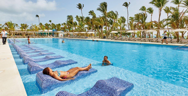 in-pool-loungers-riu-palace-punta-cana