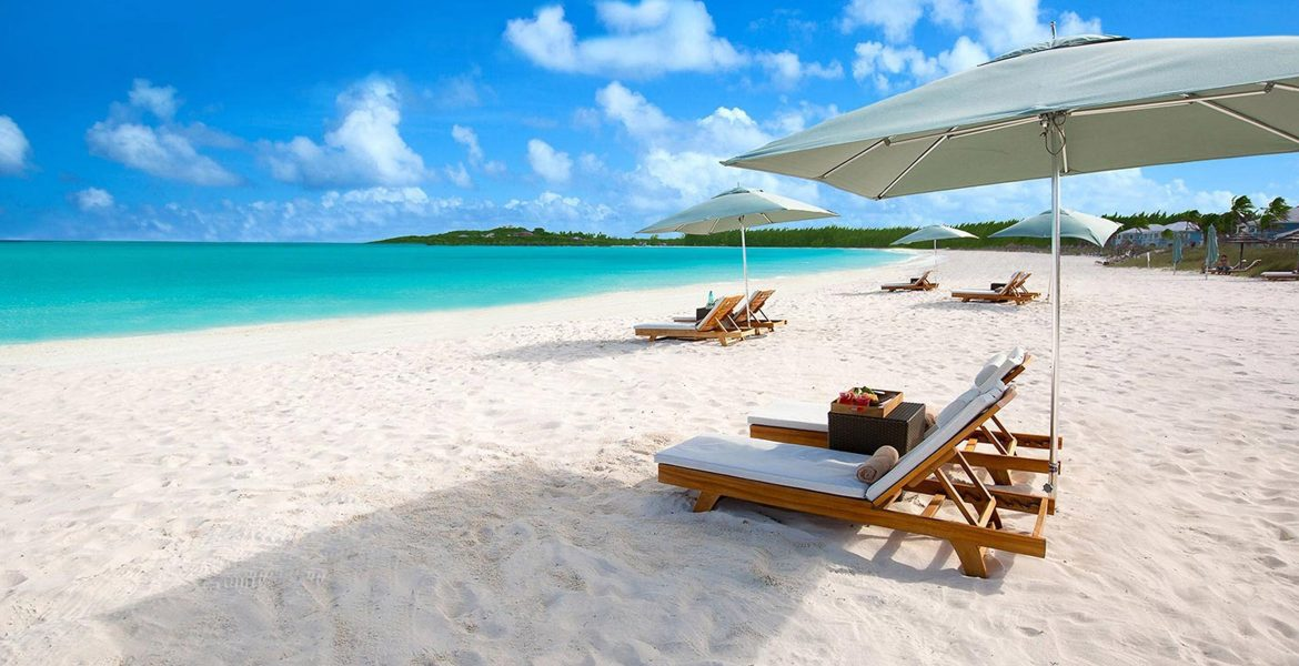 white-sand-sandals-emerald-bay-exumas-bahamas