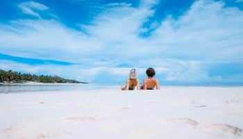 couple-beach-blue-sky