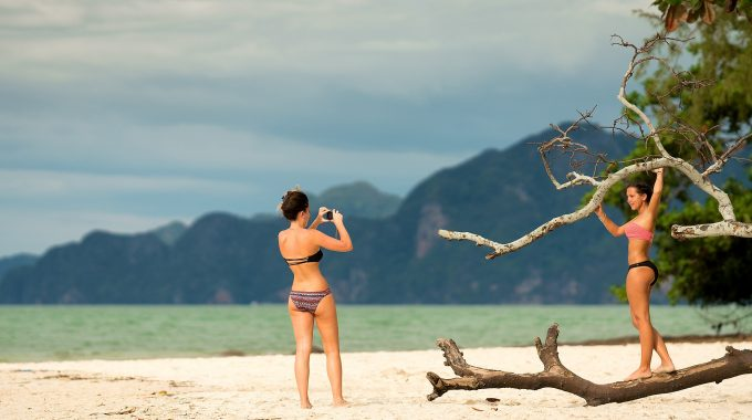two-women-taking-pictures-on-beach