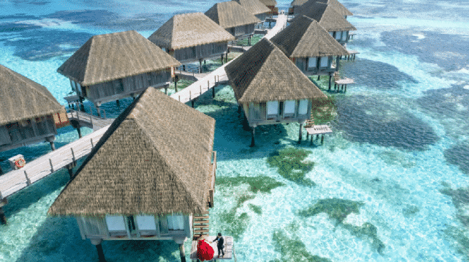overwater-bungalow-turquoise-water-couple