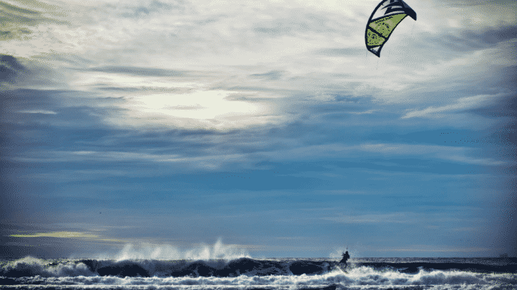 kiteboarder-waves-sunset