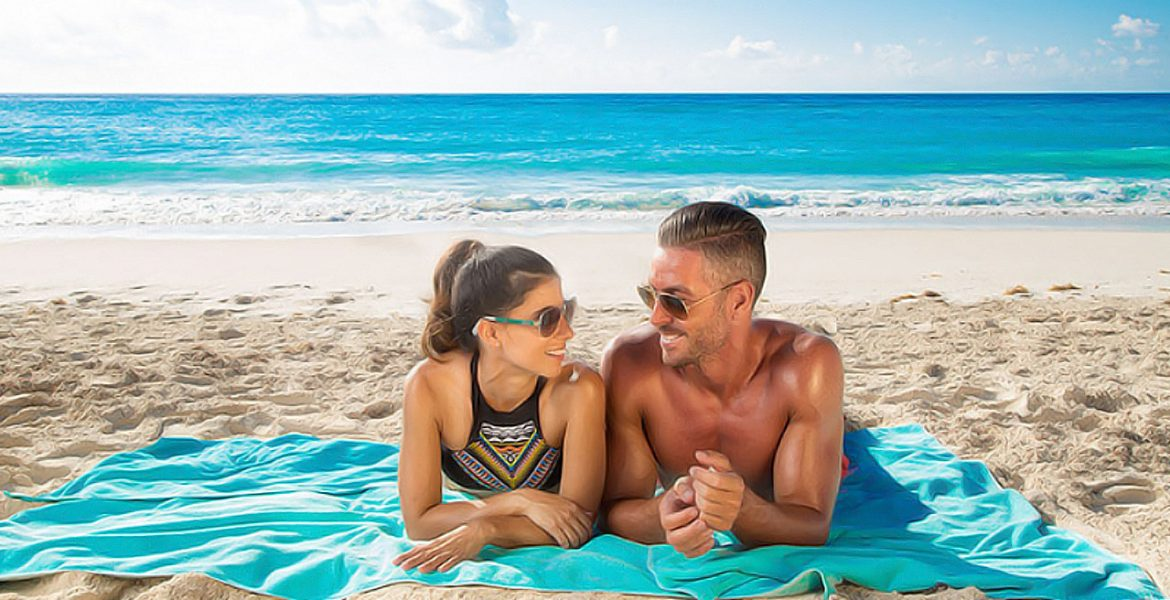 couple-laying-beach-royal-sands-resort-spa-cancun