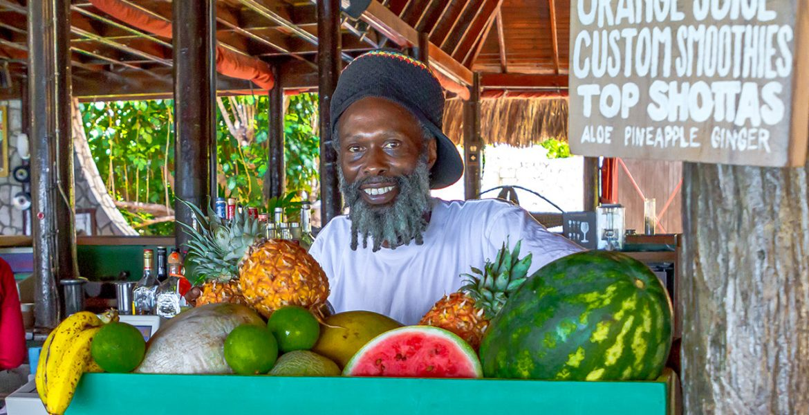 rockhouse-hotel-negril-jamaica-fruit-stand-man