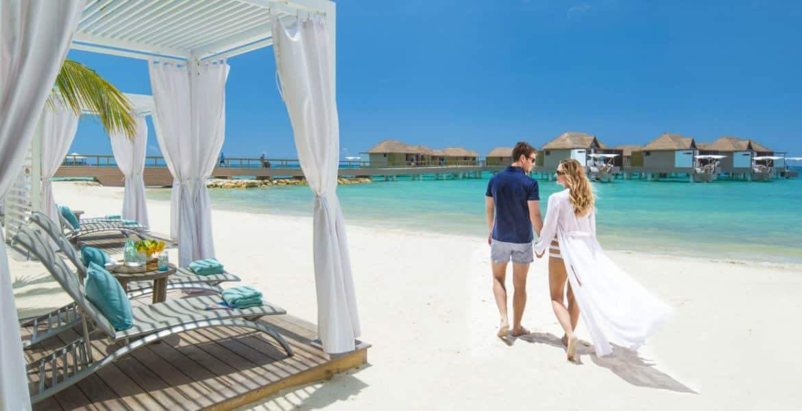 couple-beach-sandals-resort