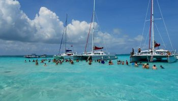 turquoise-water-anchored-boats-people-swimming