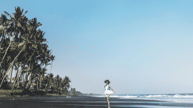 girl-walking-away-black-sand-beach