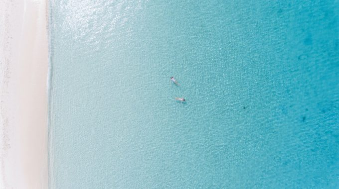 floating-people-blue-water-grand-cayman