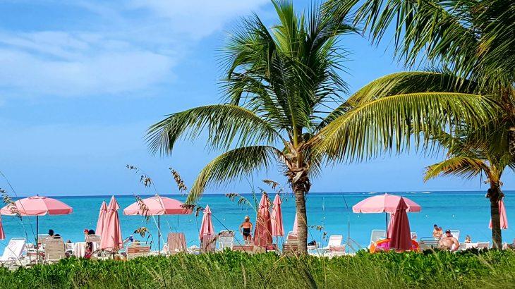 providenciales-turks-caicos-beach-pink-umbrellas