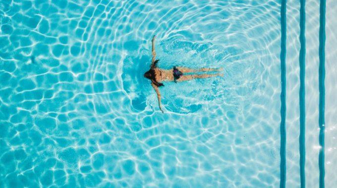 girl-swimming-pool-water-blue