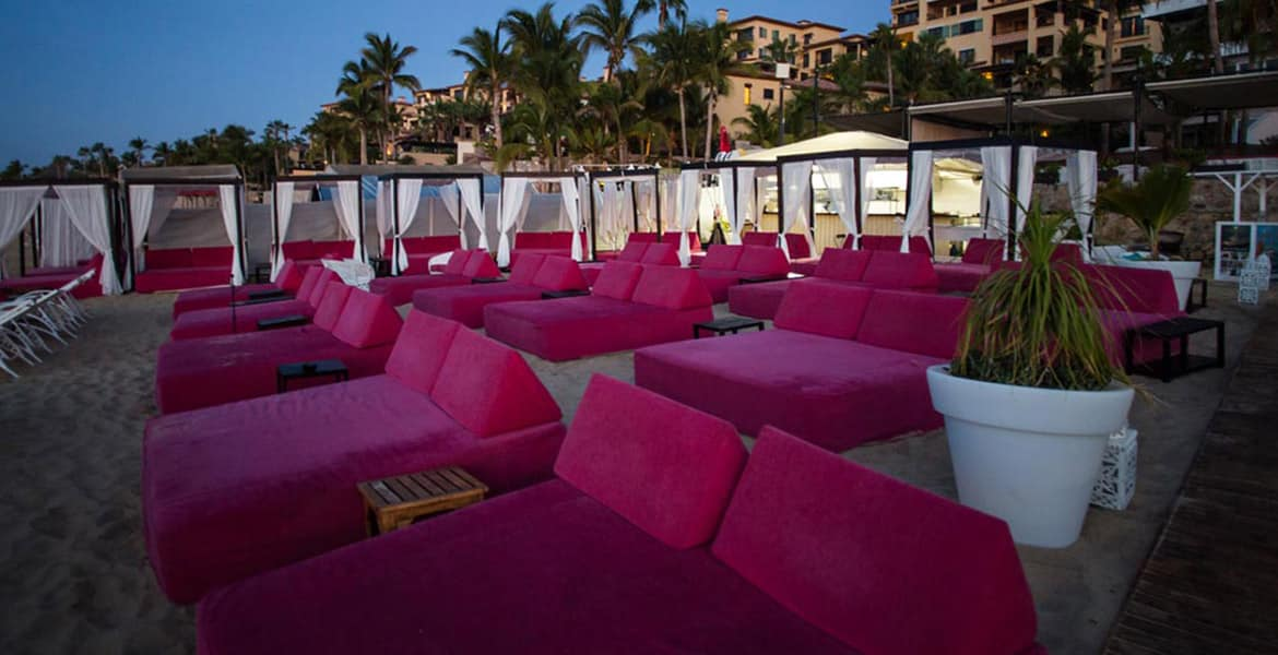 hot-pink-loungers-on-beach-sunset