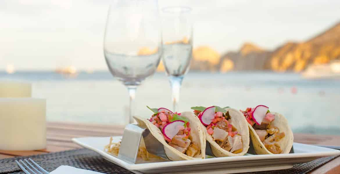 tacos-and-wine-glasses-overlooking-ocean