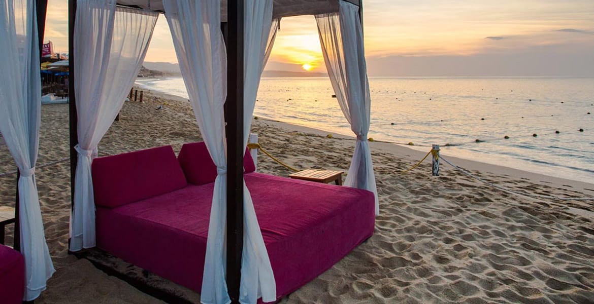 hot-pink-bali-bed-on-beach-at-sunset
