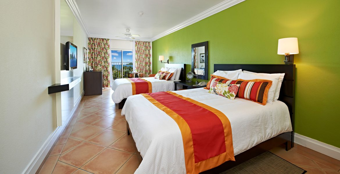resort-suite-green-walls-white-bed