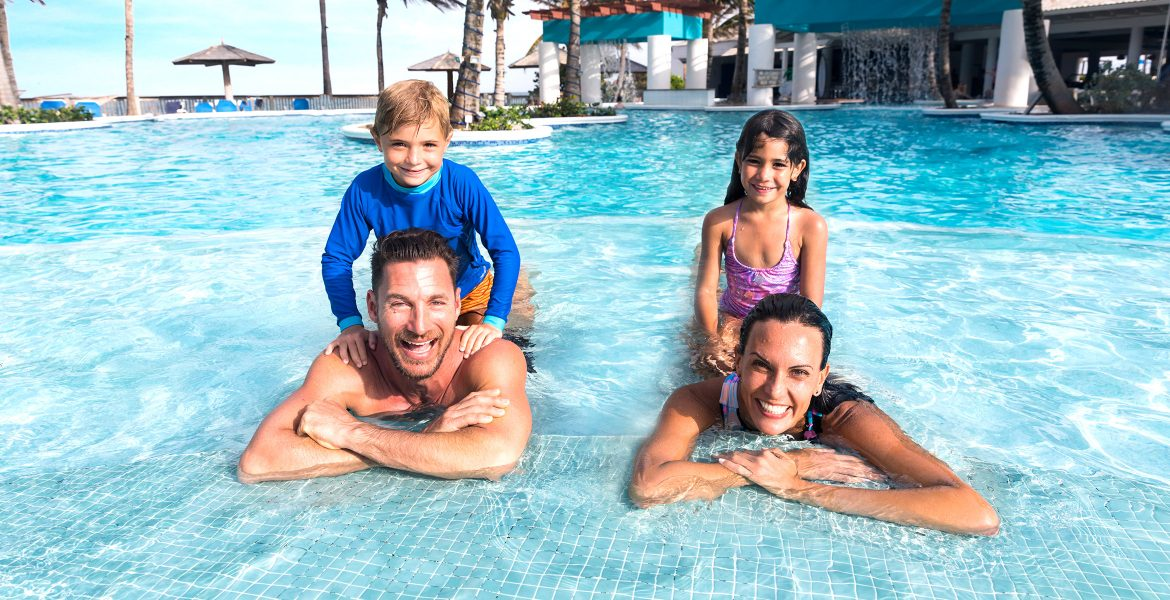 parents-children-in-pool-on-shoulders