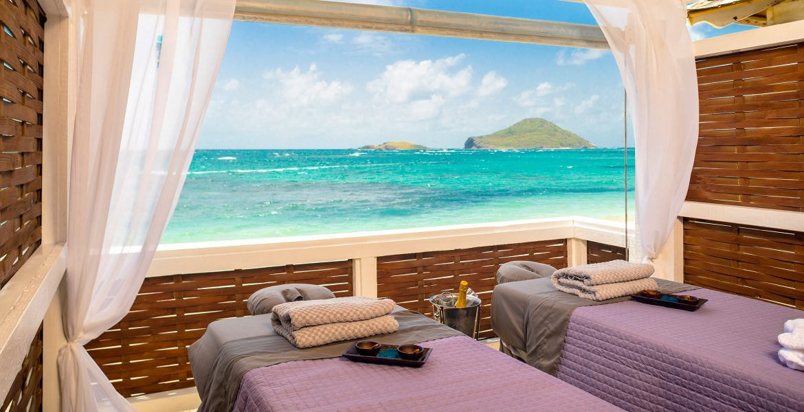 open-spa-room-massage-tables-overlooking-ocean-and-island