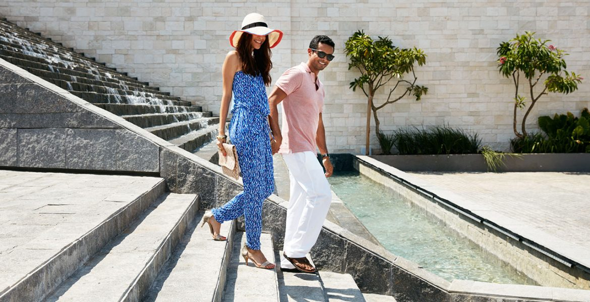 fancy-couple-walking-down-resort-steps