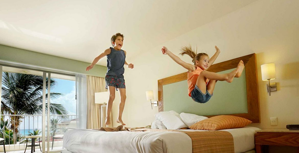 kids-jumping-on-hotel-beds