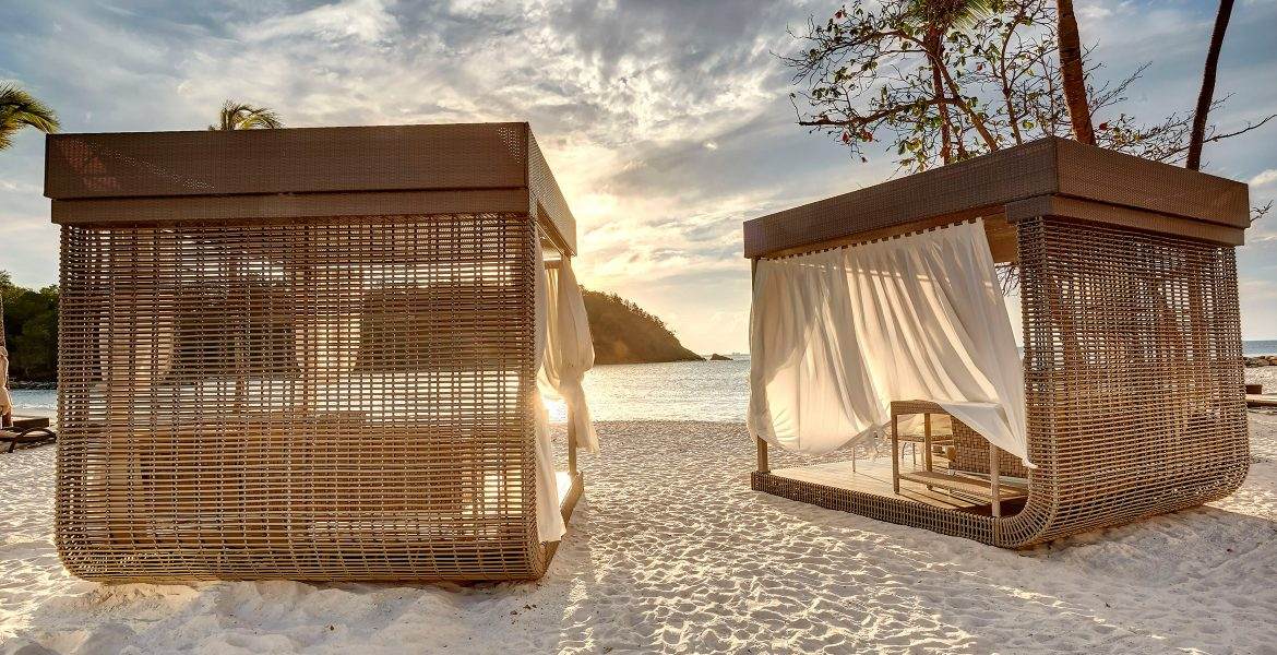 beach-cabanas-white-sand-sunset