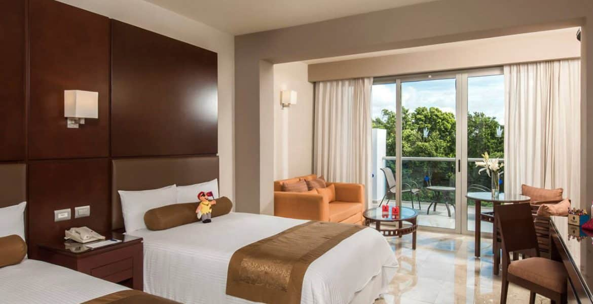 resort-suite-plush-white-bed-balcony
