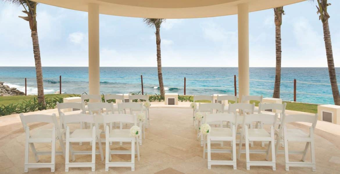 beach-wedding-setup-white-chairs-white-sand-ocean-view
