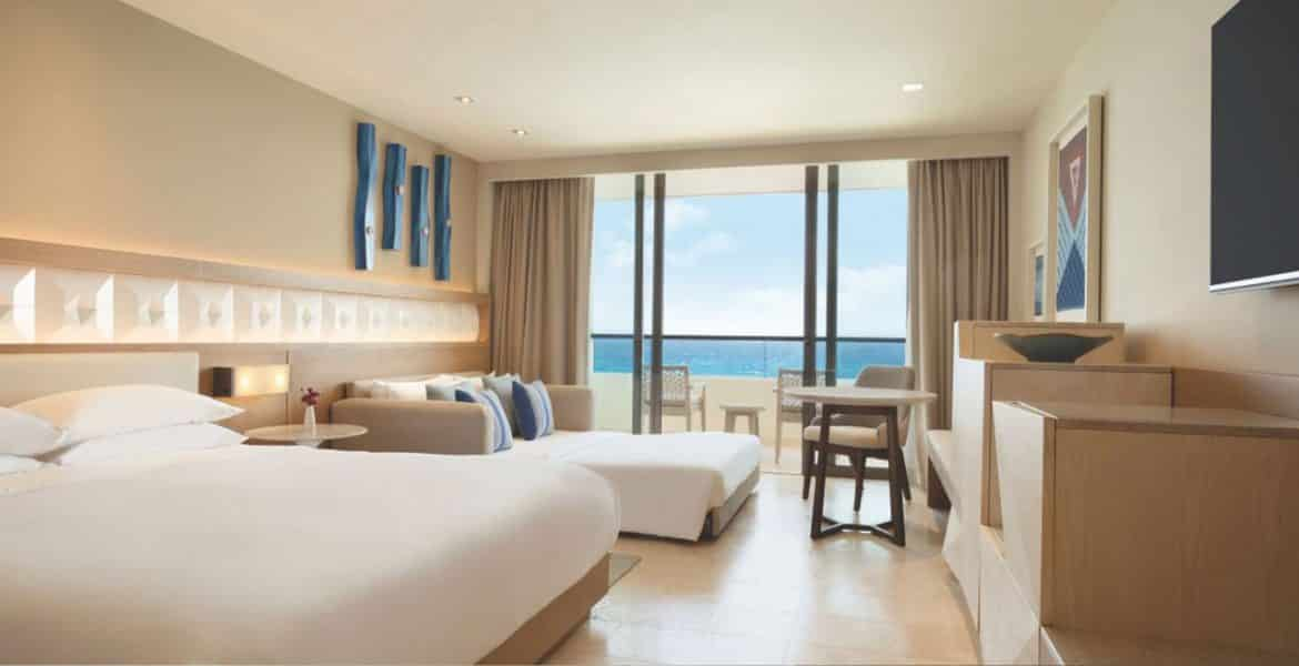 hotel-suite-two-white-beds-ocean-view-balcony