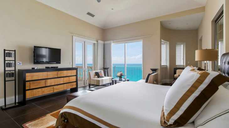 luxury-suite-master-bedroom-plush-bed-ocean-view