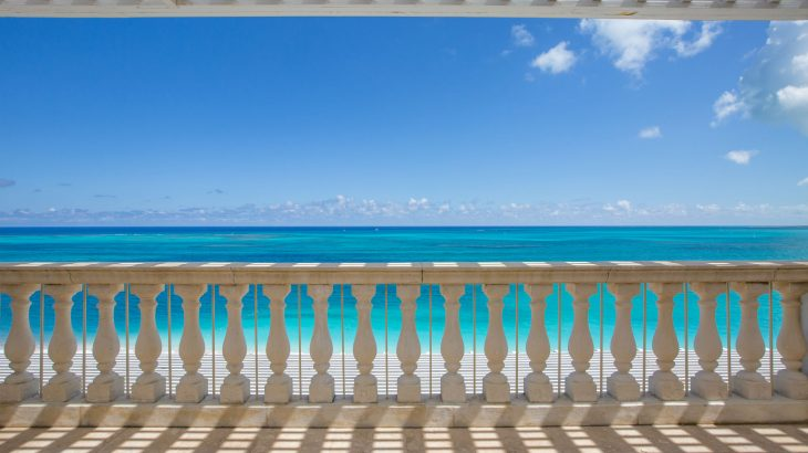 luxury-suite-balcony-turquoise-ocean-view-blue-sky