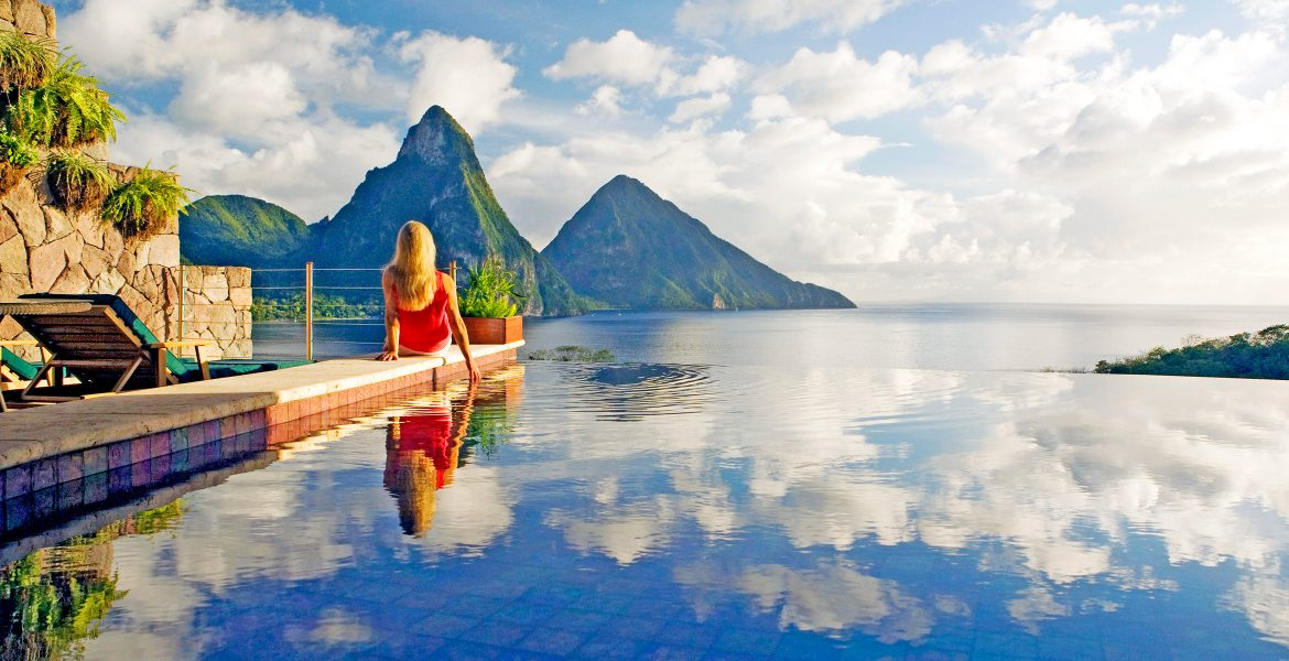 woman-sitting-edge-pool-looking-pitons-peaks