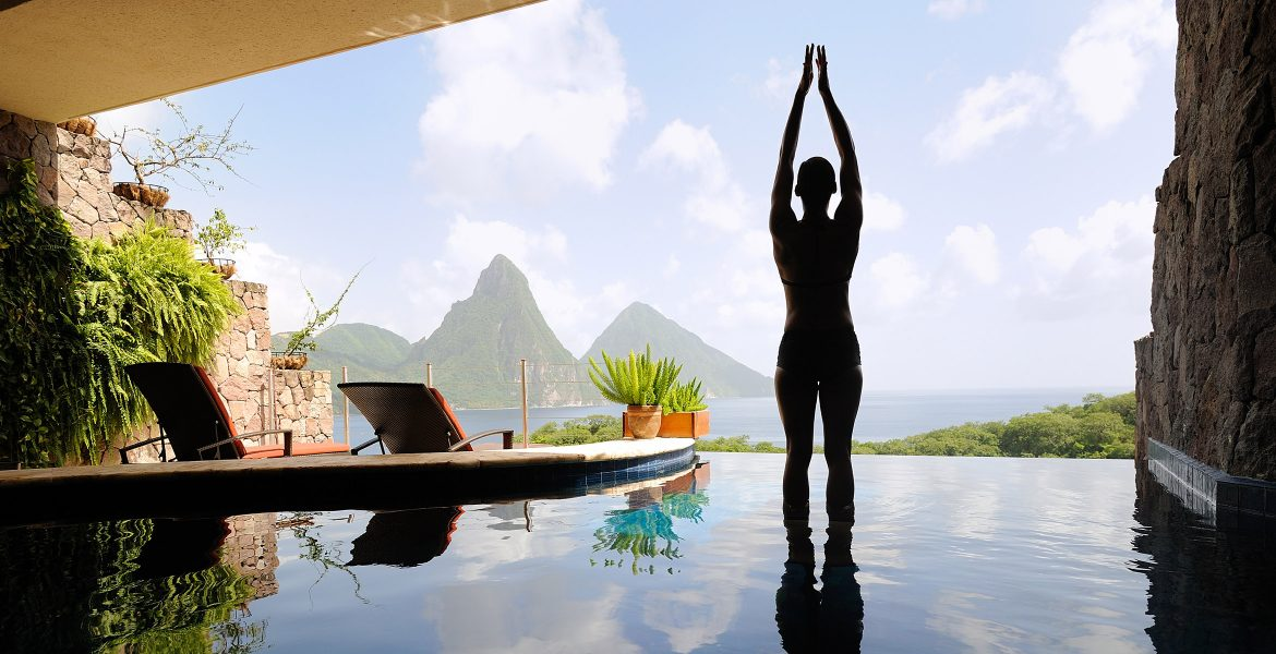 woman-doing-yoga-open-wall-facing-pitons-peaks