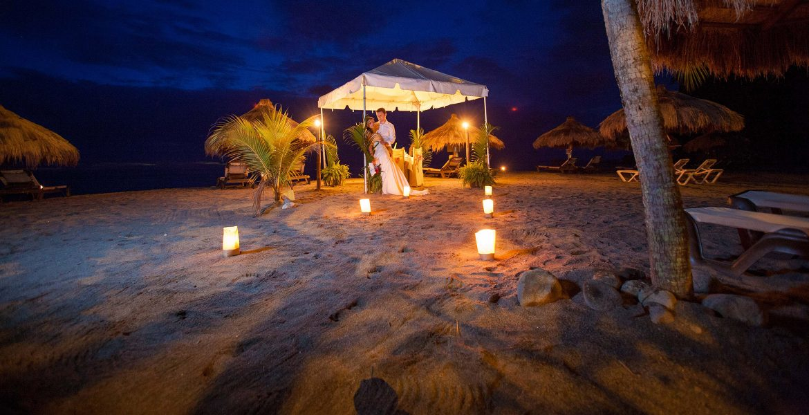 tent-on-beach-at-night-with-bride-and-groom