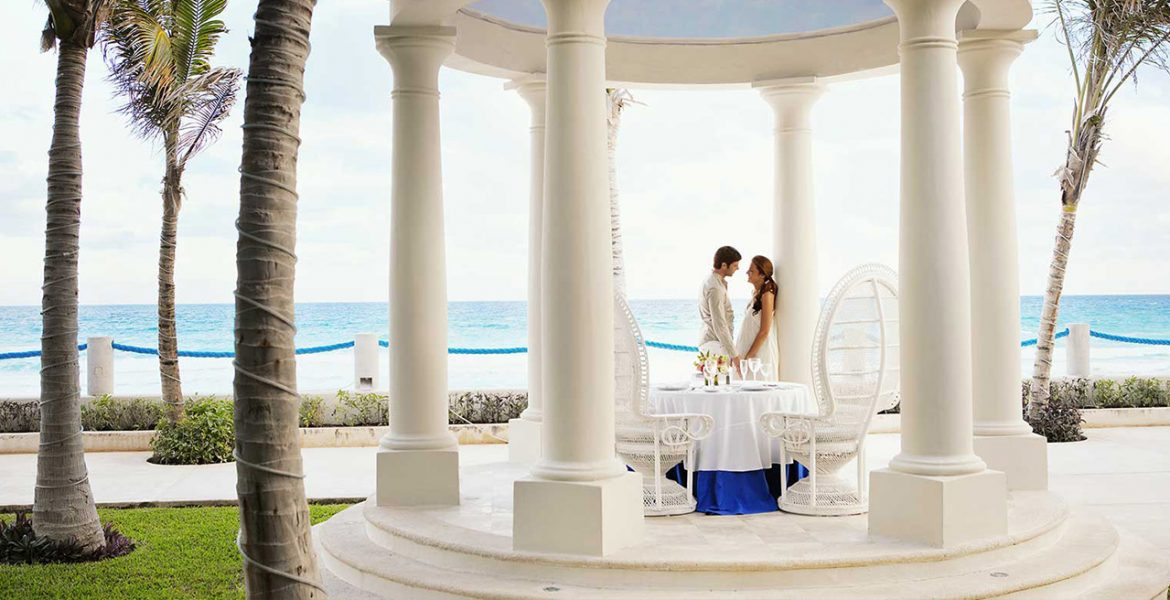 resort-white-wedding-veranda-couple-close-underneath