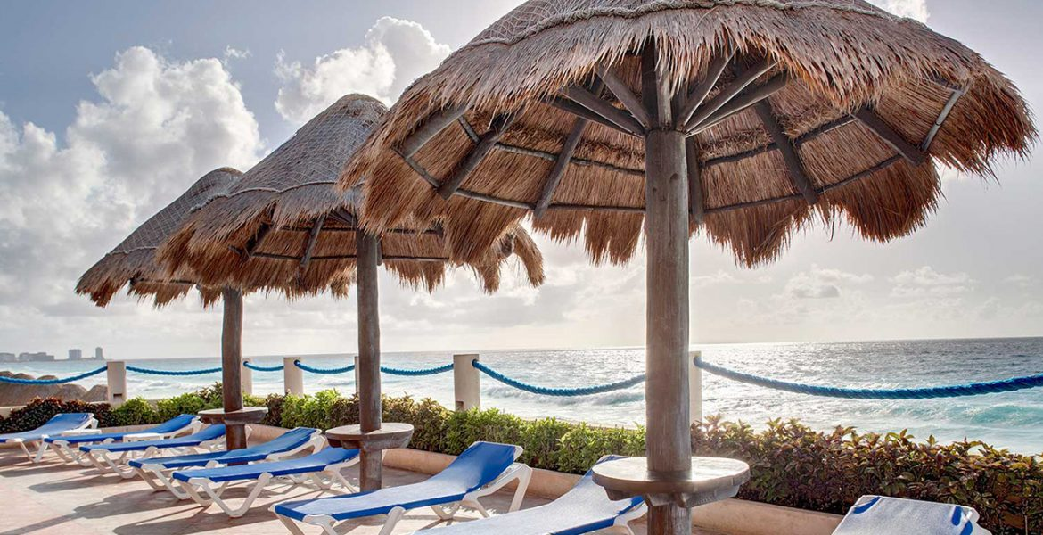 resort-pool-area-loungers-tiki-umbrellas