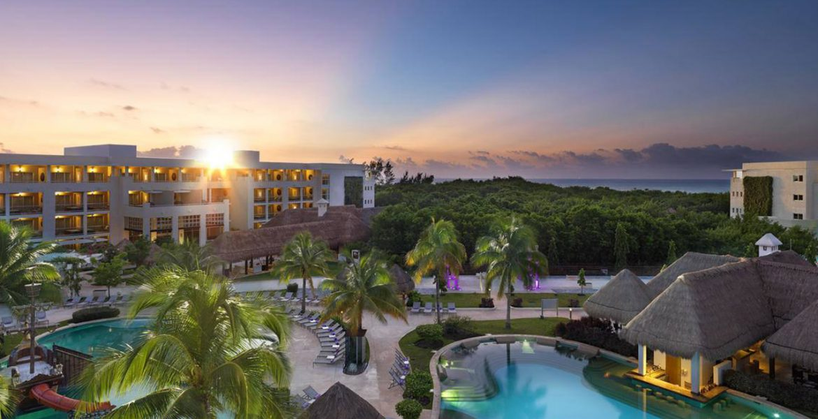 aerial-view-beach-resort-sunset-buildings-palm-trees