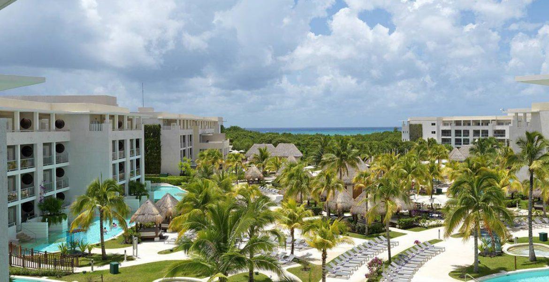 aerial-view-beach-hotel-buildings-palm-trees
