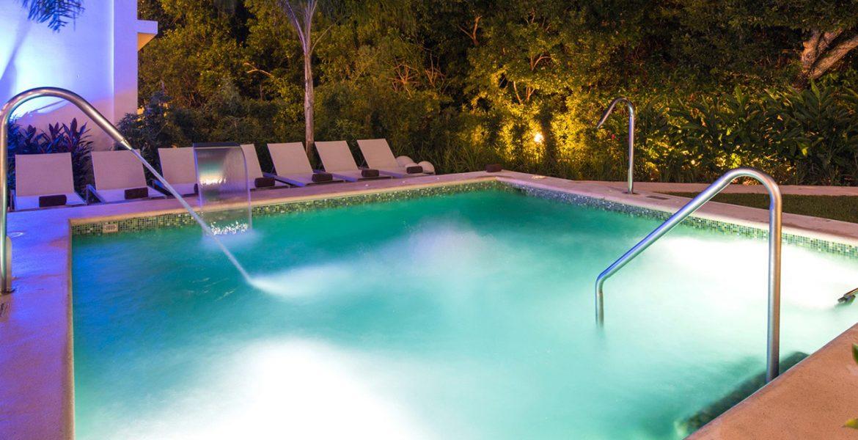 resort-turquoise-pool-nighttime