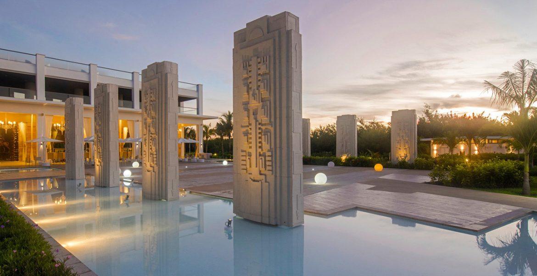 resort-pool-stone-art-sunset