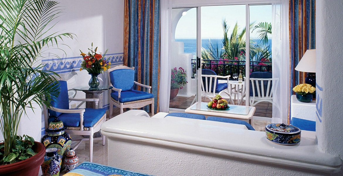 resort-suite-sitting-area-blue-decor-balcony-view