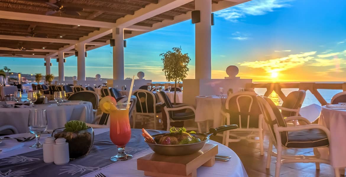 open-air-dining-at-resort-sunset-overlooking-ocean
