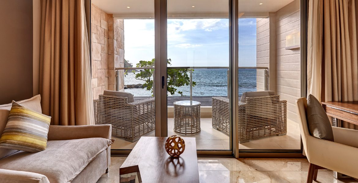luxury-suite-glass-door-balcony-overlooking-ocean