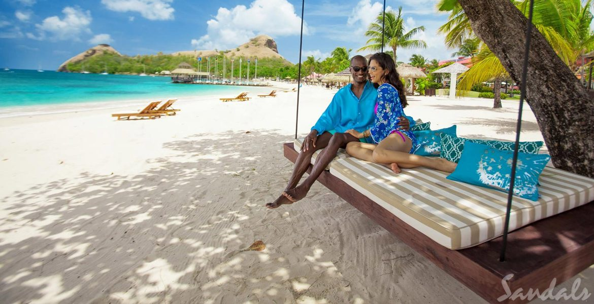 couple-on-hanging-bed-on-beach-sandals-grand-st-lucian