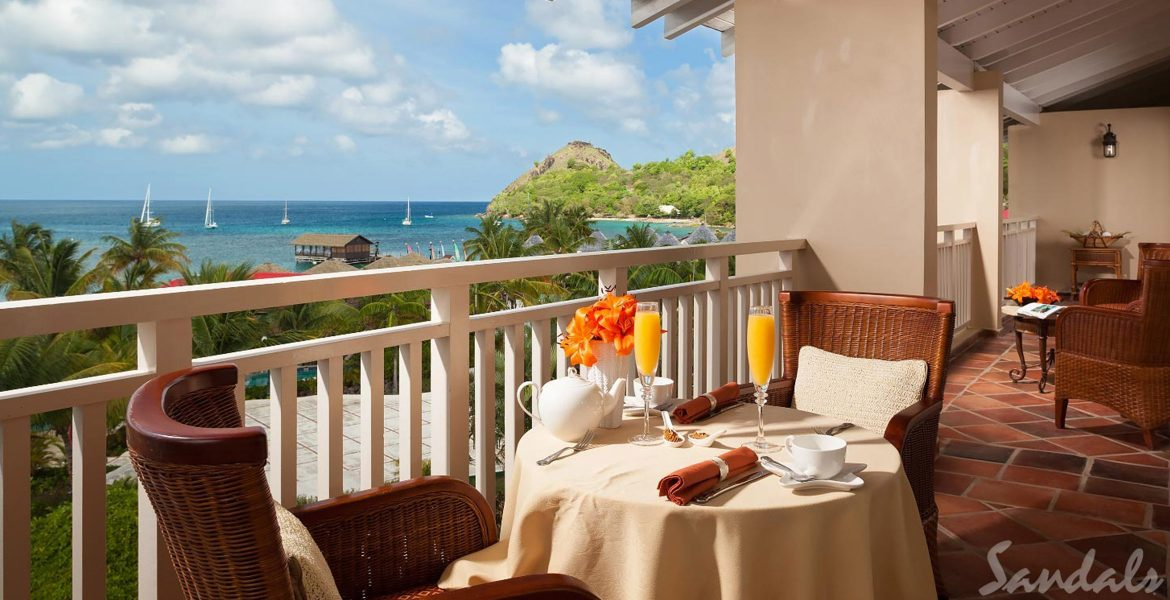 dining-balcony-overlooking-cove-sandals-grand-st-lucian