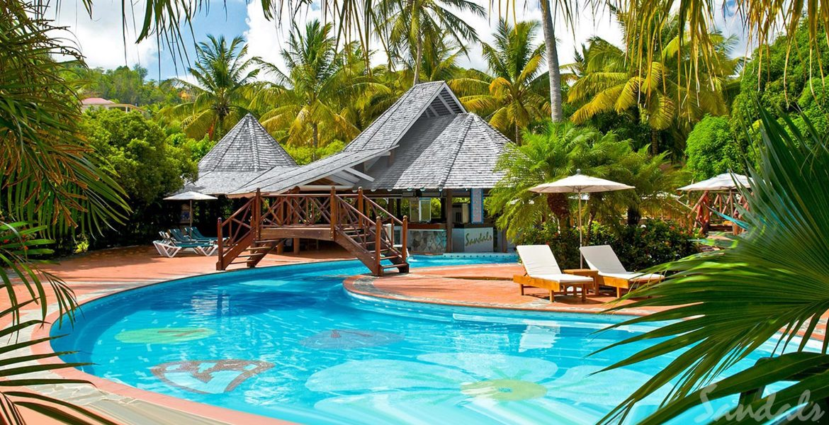 clear-pool-beach-chairs-huts-green-palm-trees