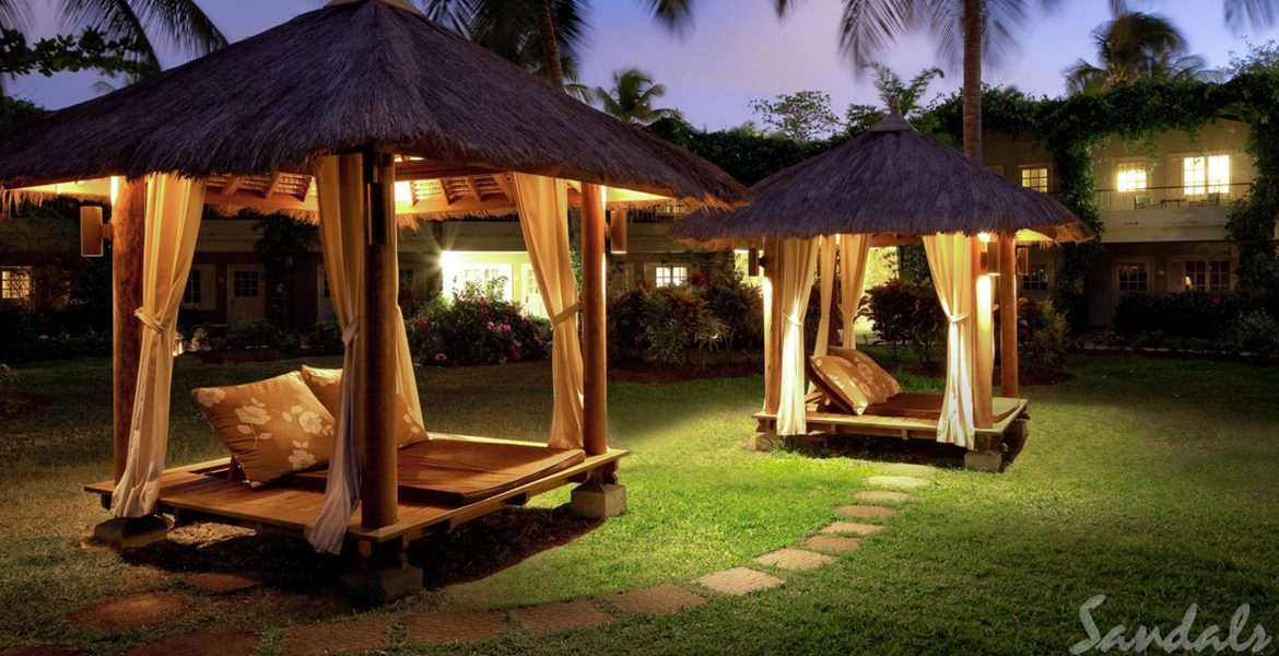 cabanas-on-grass-sunset