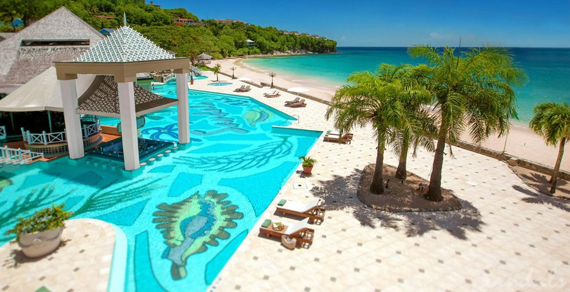 sandals-resort-pool-palm-trees